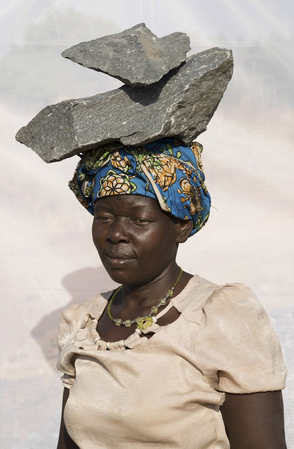 A. Fath: Age 30 . Working in quarry for 10 years. Works in quarry breaking stones into gravel. Fills 10 jerry-cans of gravel per day at 1,000 shillings per ($0.32 USD) thumbnail