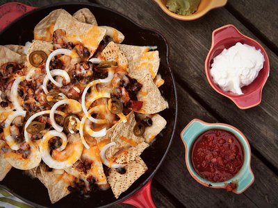 Chorizo nachos are just one of the many delicious options for spicing up Sunday's game.