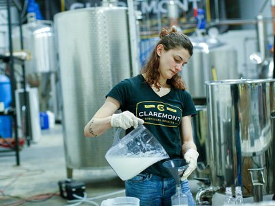 Sara Cartelli fills bottles with a hand sanitizer at the Claremont Distillery during the coronavirus pandemic on March 20, 2020 in Fairfield, New Jersey. Distillery owner Tim Koether will offer it to the general public for free.