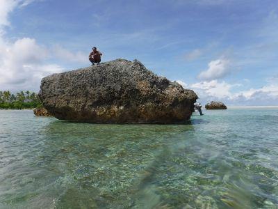 Three giant rocks—Tokia, Rebua, and Kamatoa—sit in the ocean south of Makin Island in the Republic of Kiribati.