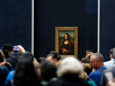 Tourists wait to see Leonardo da Vinci's Mona Lisa.