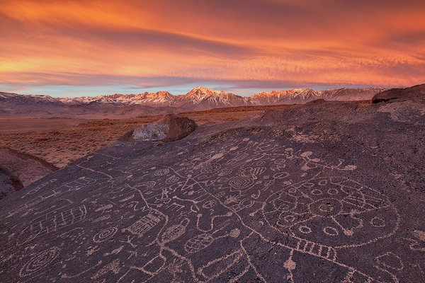 A beautiful sunrise over an amazing set of ancient petroglyphs facing the heavens with the Eastern Sierras in the backdrop. thumbnail