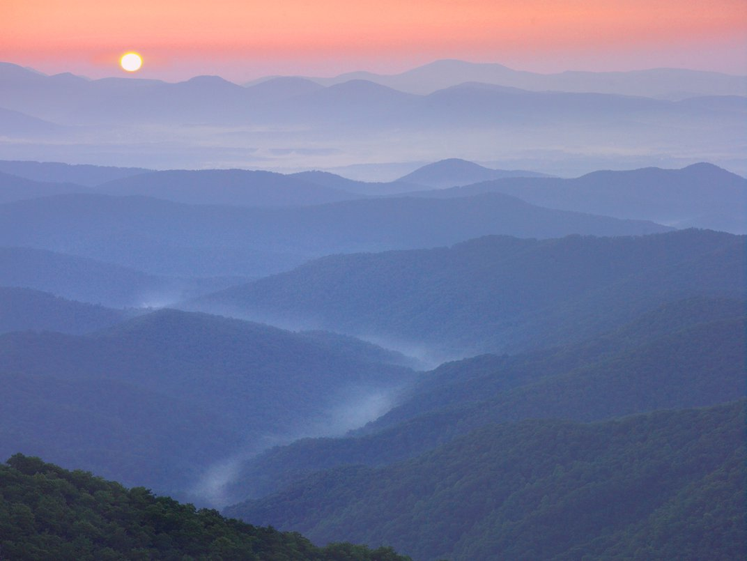 Sunset over the Pisgah National Forest from the Blue Ridge Parkway, NC. (Tim Fitzharris/Minden Pictures/Corbis)
