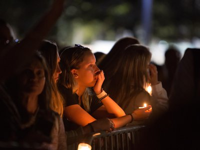 People attend a vigil for the victims of the shooting at Marjory Stoneman Douglas High School, in Pine Trails Park in Parkland, Florida on February 15, 2018.