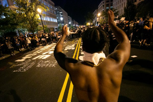A man energizes a group of demonstrators in Washington, D.C. thumbnail