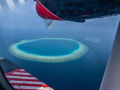 The ring-shaped coral islands known as atolls, like this one in the Maldives Islands in the Indian Ocean, may trace their formation to sea levels repeatedly rising and falling over hundreds of thousands of years, geologists say.