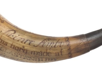 Likely made from a cow's horn, this Revolutionary War era gunpowder holder belonged to patriot fighter Prince Simbo.