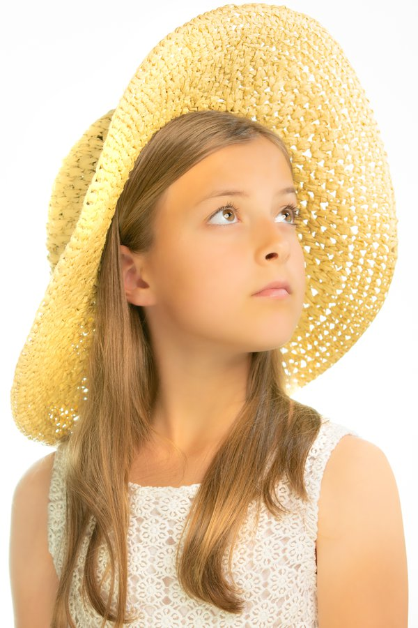 girl in sun hat thumbnail