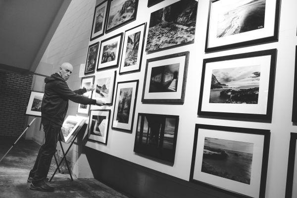 Arranging photos before First Thursday Artwalk Gallery Showing thumbnail