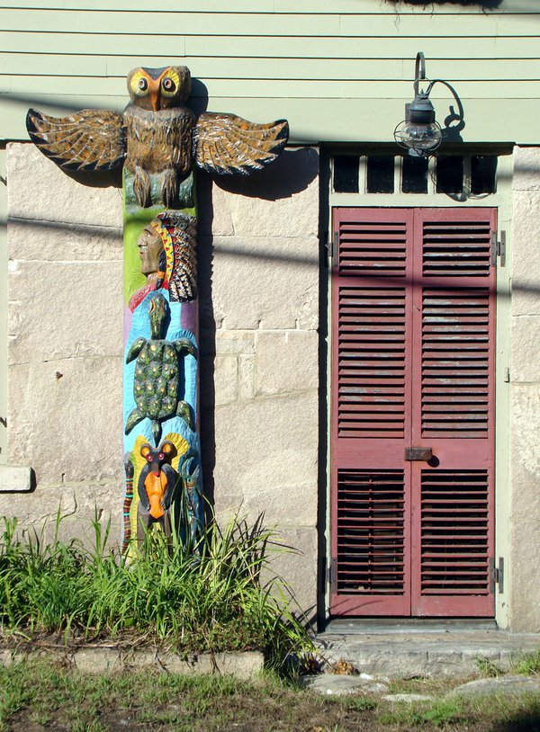 Colorful totem on old house in Mystic, Conn. thumbnail