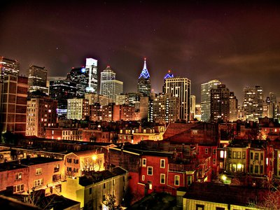 The lights of the Philadelphia skyline at night.