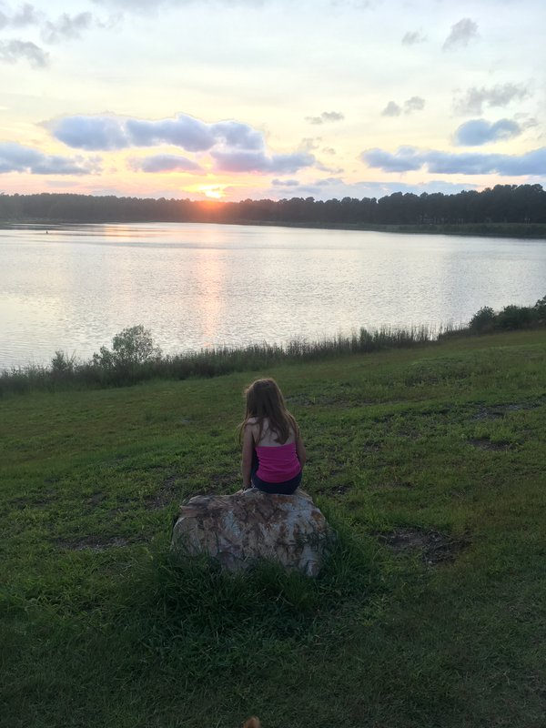 Child watching a Summer sunset. thumbnail