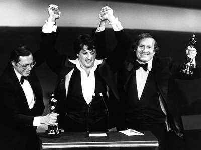 Producers Irwin Winkler, Sylvester Stallone, Robert Chartoff with their Academy Awards for Rocky, 1977