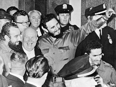 Soviet Premier Nikita Khrushchev, left, and Cuban President Fidel Castro, center, are seen outside the Hotel Theresa in the Harlem neighborhood of New York.