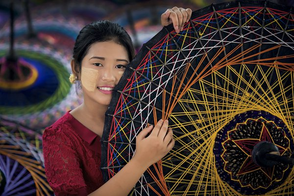 A girl with colourful umbrellas thumbnail