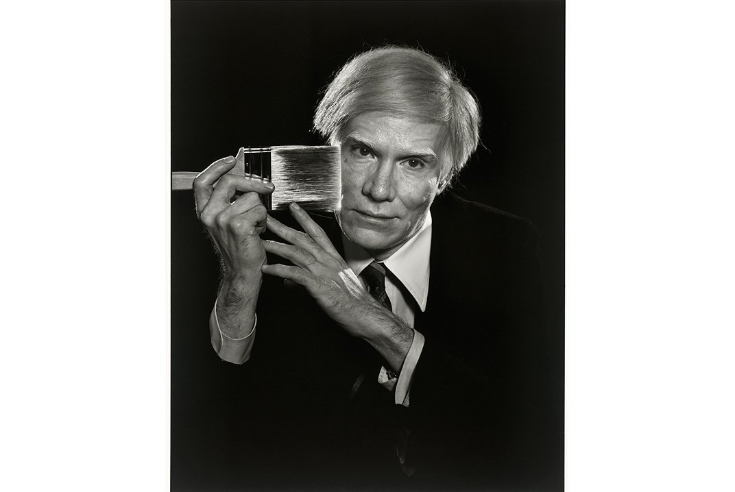 """A pop culture visionary, Andy Warhol put the """"art"""" in """"artifice."""" Photograph of """"Andy Warhol"""" by Yousuf Karsh, 1979. ©Estate of Yousuf Karsh. Gift of Estrellita Karsh in memory of Yousuf Karsh. NPG, SI"""