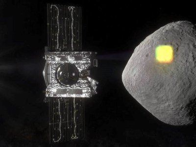 Bennu is shaped like a three-dimensional diamond and seemingly smooth from far away. OSIRIS-REx is in the foreground of this artist's replication. The spacecraft will gather a sample from Bennu next week. (NASA/Goddard/University of Arizona)
