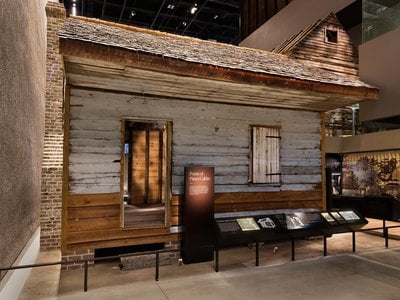"""""""What I also want people to understand is that as difficult as this history is, it's ripe with optimism,"""" says the museum's director Lonnie Bunch. """"Because if you can survive that cabin, there's a lot more you can survive."""""""