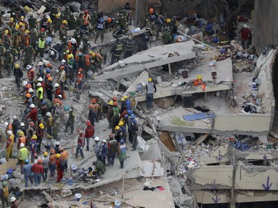 Rescue workers search for survivors among the rubble of a collapsed building in Mexico City. Structures throughout the capital were devastated during yesterday's earthquake.