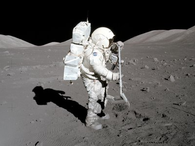 Harrison Schmitt, Apollo 17 astronaut and geologist, collecting samples of lunar soil in 1972. Along with Eugene Cernan, Schmitt collected about 245 pounds of material for return to Earth.