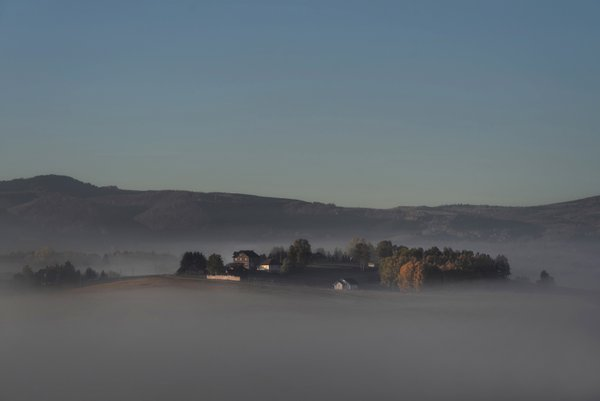 A Hill Surrounded by Fog thumbnail