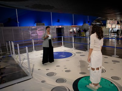 In the installation, astronaut Mae Jemison appears as a 3D rendering (above, left) and discusses her career and those of other women involved in the space program.