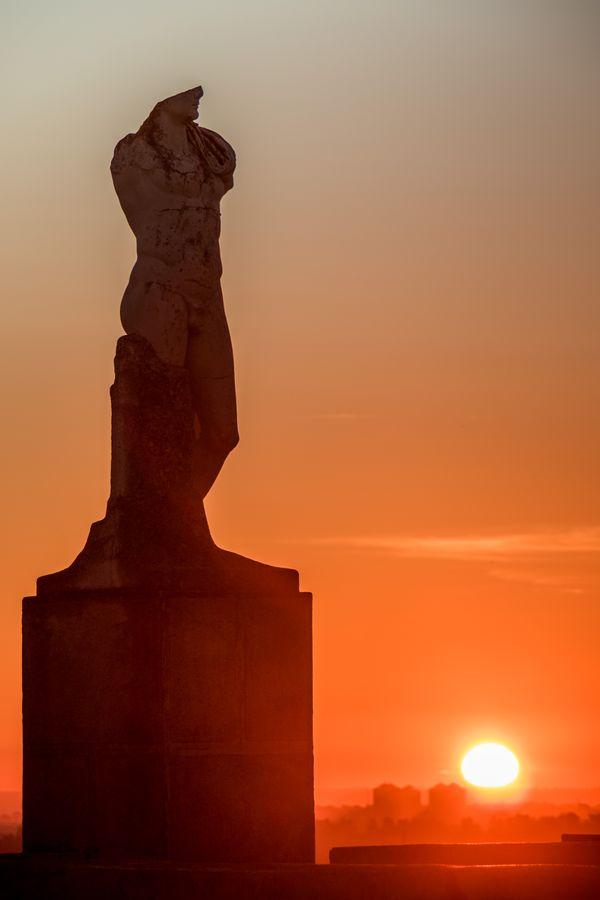 Sculpture of Emperor Trajan at sunrise thumbnail