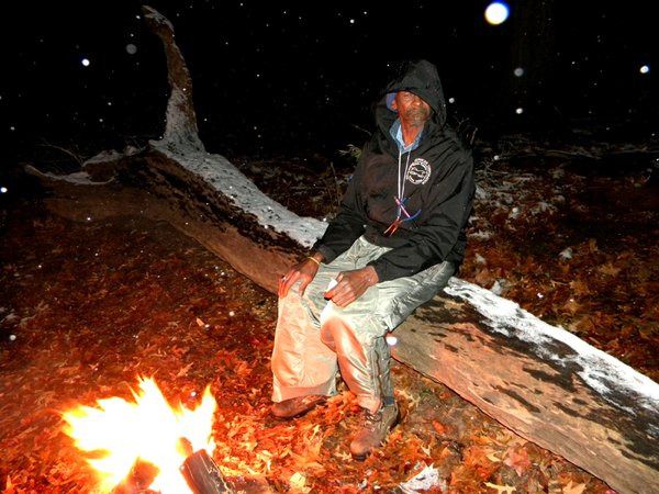 Surviving - old man surviving winter, warm fire, pliers, and pen. thumbnail