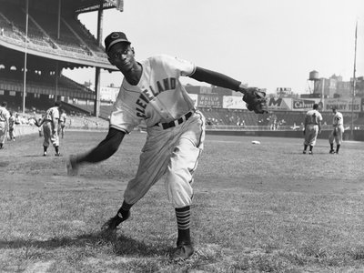 Satchel Paige pitches during warmups for Cleveland on August 30, 1948. Signed midway through the MLB season, Paige became the first African American to pitch in the American League.