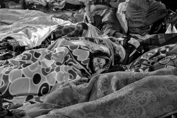 Pilgrims sleeping out in the open at Ganga Sagar. Nikon D750, 24-120 Lens, f/5, ISO-2500, s-1/25s, f-120mm thumbnail