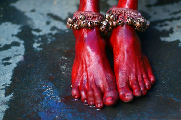 Feet of an exhausted Bhel Bhel devotee wearing a ghungroo thumbnail