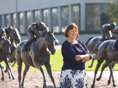 """""""Horses define Lexington in many ways,"""" says Edwards (with Thoroughbred Park's statues)."""