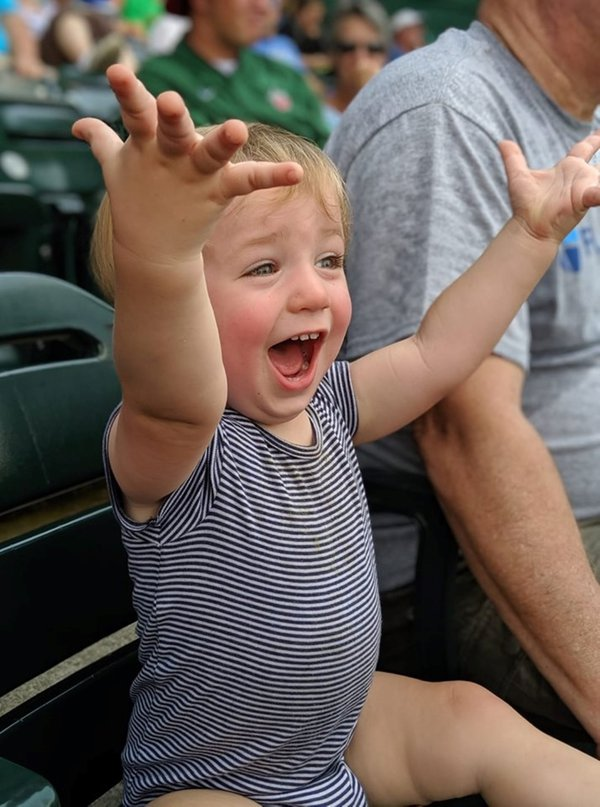 Cheering Toddler at a Baseball Game thumbnail