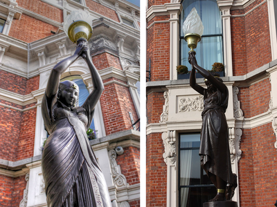 The statues have stood outside of the Shelbourne Hotel since 1867.