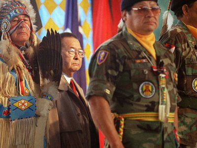 Dressed in ceremonial regalia, Senator Ben Nighthorse Campbell (Northern Cheyenne), a veteran of the Korean War, stands with World War II veteran Senator Daniel K. Inouye and Native American veterans of the Vietnam War during the opening of the National Museum of the American Indian on the National Mall. October 21, 2004, Washington, D.C.