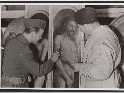 Lieutenant Daniel J. Kern and Karl Sieber examining a panel of the Ghent Altarpiece, 1945.