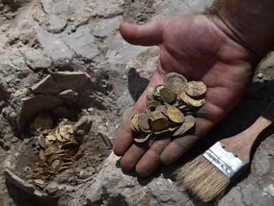 Two volunteers found a cache of 425 gold coins that date back to the ninth century A.D.