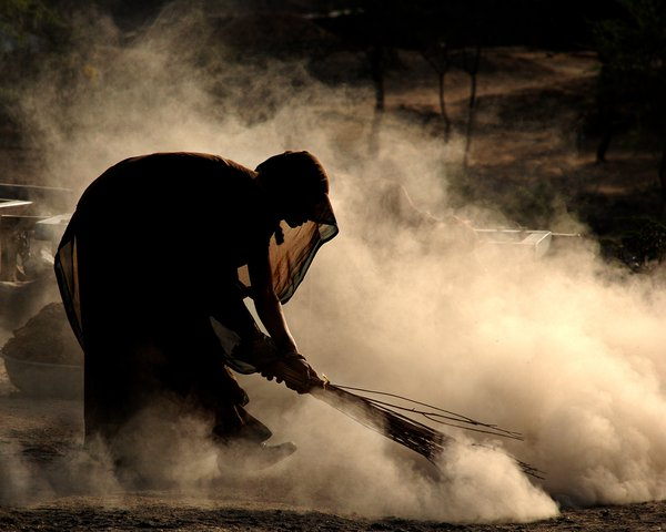 The Village woman is cleaning outside her house. thumbnail