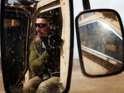A photographer with Reuters, Finbarr O'Reilly, in southern Afghanistan's Helmand province during 2011