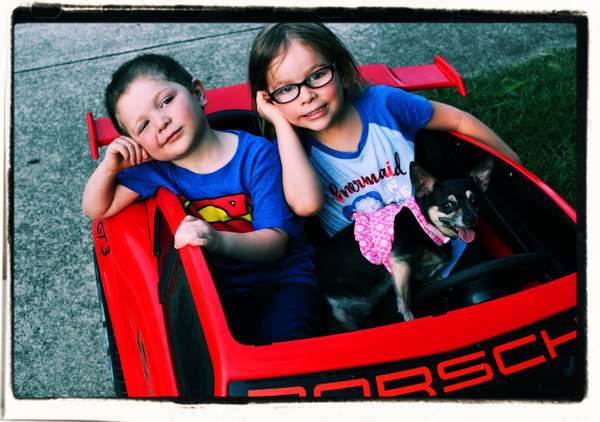 Boy, Girl, and Chihuahua Out for a Spin thumbnail