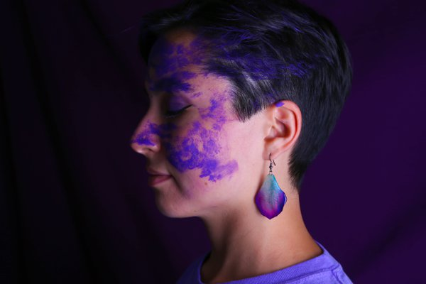 A face painted with purple thumbnail