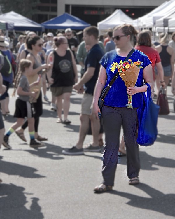 A figure with a gorgeous bouquet at a market thumbnail