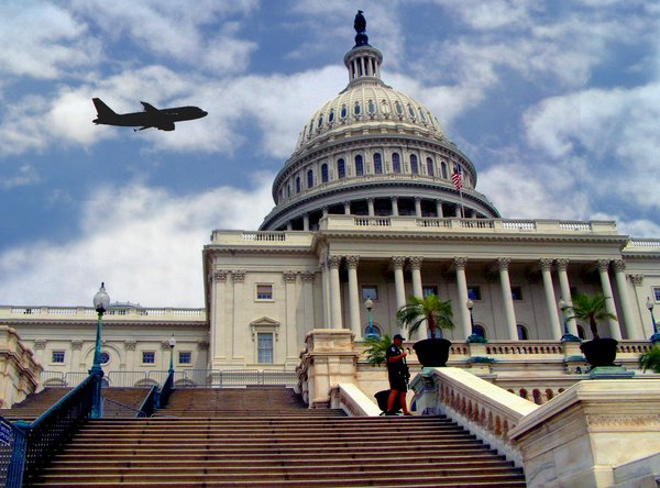 This shot of the US Capitol in Washington DC showing a low flying plane too close for comfort. thumbnail