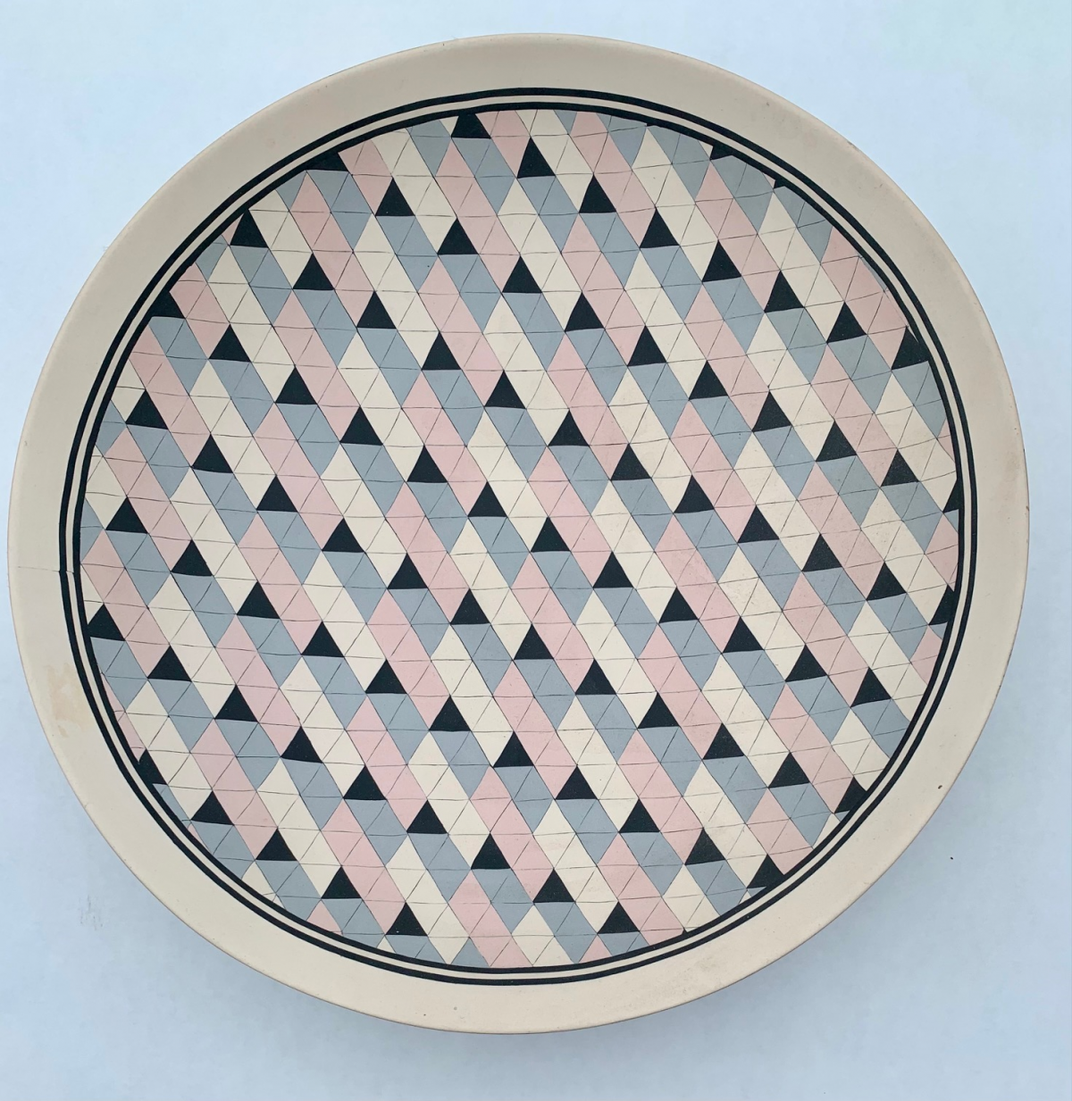 Ceramic plate with quilt motif.