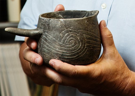 """Pottery beakers were used to hold the """"Black Drink""""."""