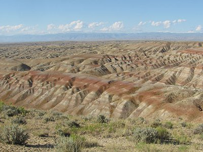 The badlands north of Worland, Wyoming, shown here, expose sediments deposited during the Paleocene-Eocene Thermal Maximum.
