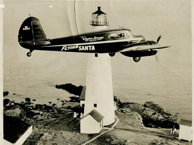 Flying Santa plane flies past Boston Light in 1947.