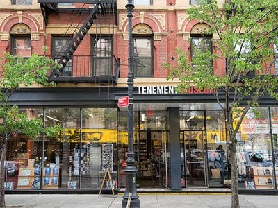 The Tenement Museum depicts the life of early immigrants in tenement housing at the turn of century in New York City.