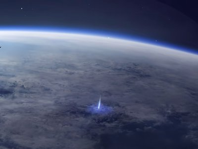 Artist's rendering of blue jet lightning blasting from a storm cloud towards space. The International Space Station solar panels can be seen in the foreground.