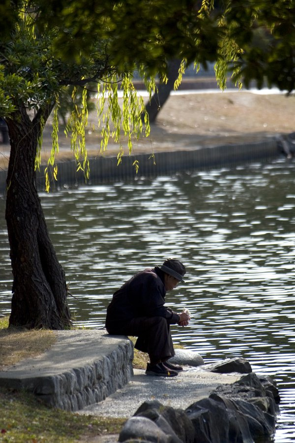 lonely man in the park thumbnail